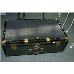 A  vintage steamer trunk with metal bindings