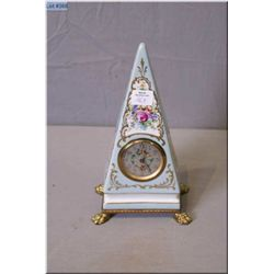 A French made porcelain clock hand painted for Birks Canada, running at time of cataloguing