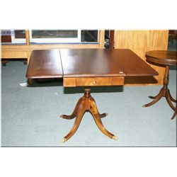 Antique Regency style drop leaf table with single pedestal and drawer