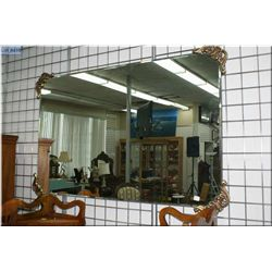 Bevelled wall mirror with attached cast corner decorations