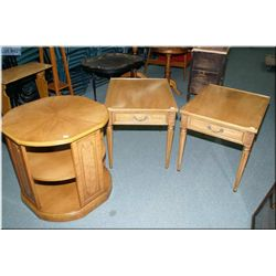 A pair of single drawer side table with tapered supports and a round two tier occasional table