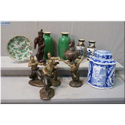 A selection of Oriental collectibles including fighting figures, lidded jar, stone incense  burner,