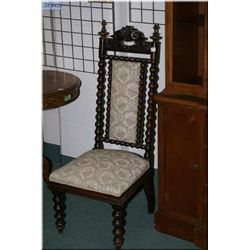 Antique tapestry upholstered side chair with carved decoration and bob and turn design throughout