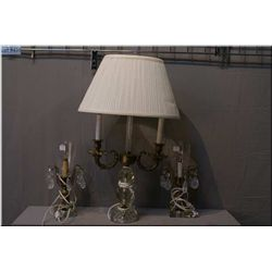 A matched pair of brass lamps with glass shades and hanging lustres and a candelabra style table  la