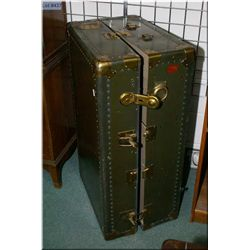 Vintage green steamer trunk with brass coloured hardware
