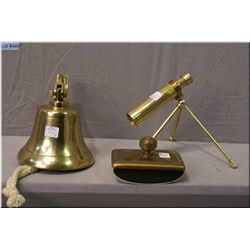 A brass ships bell, a small desk sized telescope  and a vintage ink blotter