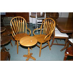 Two modern arrow back oak arm chairs and small oak occasional table