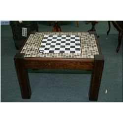 A mission style occasional table with tile top games board
