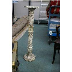 """A 38"""" high marble pedestal"""