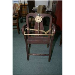 Antique wooden barber chair with reclining mechanism made by Centrifical
