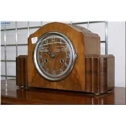 A Deco era walnut cased English chiming mantle clock