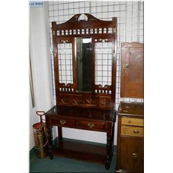 Victorian style mahogany hall stand with bevelled mirror and brass hooks
