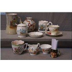 "A selection of porcelain collectibles including Royal Doulton jug ""Paddy"", moustache cups, jam  pot"