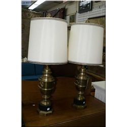A pair of vintage brass urn style double handled table lamps with shades