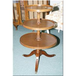 Three tier mahogany  table with Regency style legs and capped feet