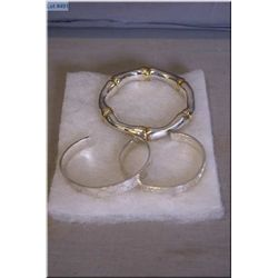 Two Gucci sterling silver bracelets and a sterling single bangle