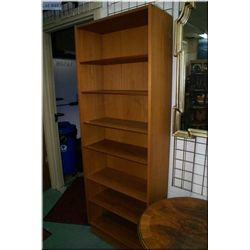 Two open teak shelf units one with cupboard  section