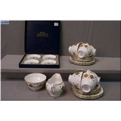 A Colclough tea set including eight cups and saucers, plus cream and sugar, six tea plates and  a bo