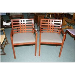 A pair of lattice back office chairs with upholstered seats