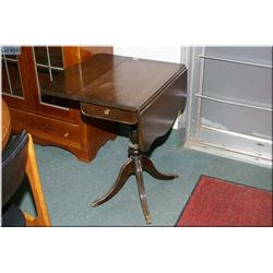 A Regency style center pedestal drop leaf occasional table with drawer