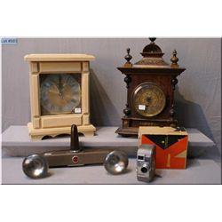A vintage Keystone 8mm camera, a Kodak brand  flash, a Westminster brand clock and an antique  clock