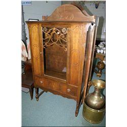 A mid 20th century walnut, single door, single  drawer china cabinet