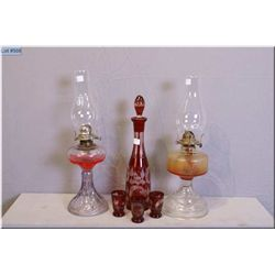 Two antique Canadiana colourless oil lamps and a ruby flash, cut to clear decanter and three glasses