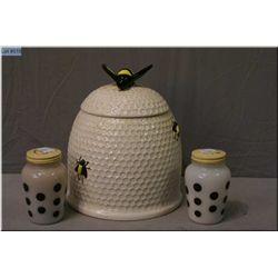 A vintage Beehive glazed pottery cookie jar and a glass salt and pepper set