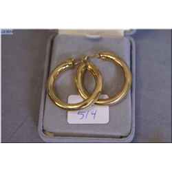 A pair of lady's 18kt yellow gold hoop earrings