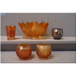 Five pieces of vintage carnival glass including a pair of Dugan Wreath of Roses vases in marigold, a