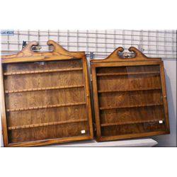 Two wall mount spoon racks with glazed doors
