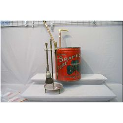 A large Shamrock lard tin with lid, two vintage walking sticks with carved handles and a fireside  c