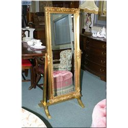 A gilt framed cheval style floor mirror