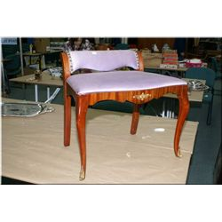 A mahogany vanity bench with attached ormolu decoration, upholstered seat and low back