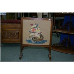 A small fire/draft screen with ship motif  needlepoint insert