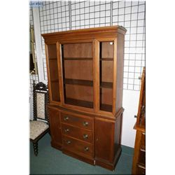 Regency style three drawer two door display cabinet
