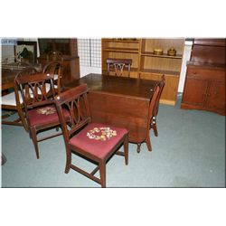 A vintage walnut drop leaf table and four needlepoint upholstered chairs