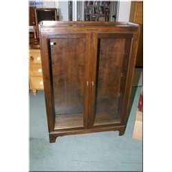 A mid 20th century walnut bookcase with two glazed doors