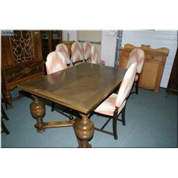 An antique draw leaf dining table with bulbous support and eight upholstered dining chairs