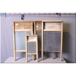"Four vintage washboards, all by Canadian  manufacturers including ""Western Broom Woodenware  Ltd"", """