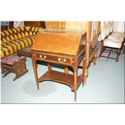 An antique drop front desk with fitted interior, brass galley, single drawer and under shelf