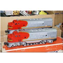 A vintage Lionel train set including two Santa Fe 2343T Diesel engines,  Type KW transformer, a  sel