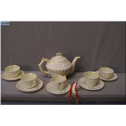 A selection of vintage Belleek Irish porcelain including Nautilus teapot, and five cups and  saucer,