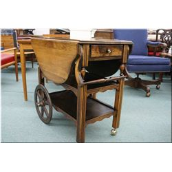 A vintage drop leaf single drawer tea wagon