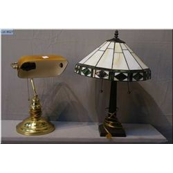 Two lamps including brass bankers lamp and a cast lamp with tiffany style glass shade