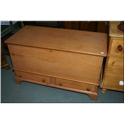 An antique Canadiana pine blanket box with drawers in base