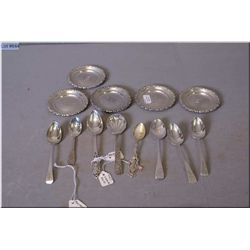 A selection of sterling silver including six  matching coasters, and eight spoons