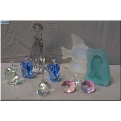 A selection of glass paperweights including signed Penguin, plus panther, small elephants etc.