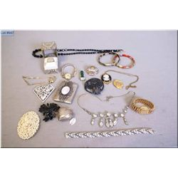A selection of vintage jewellery including signed Sherman brooch, calling card case, brooches,  neck