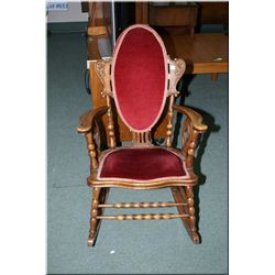 Antique oak rocking chair with carved decoration  and upholstered seat and back